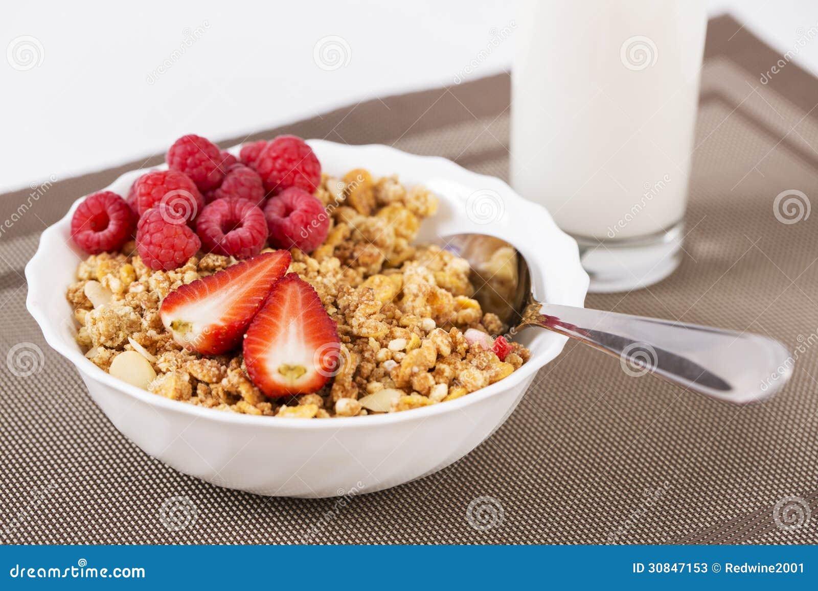 Halfs of berrie on cereals in bowl