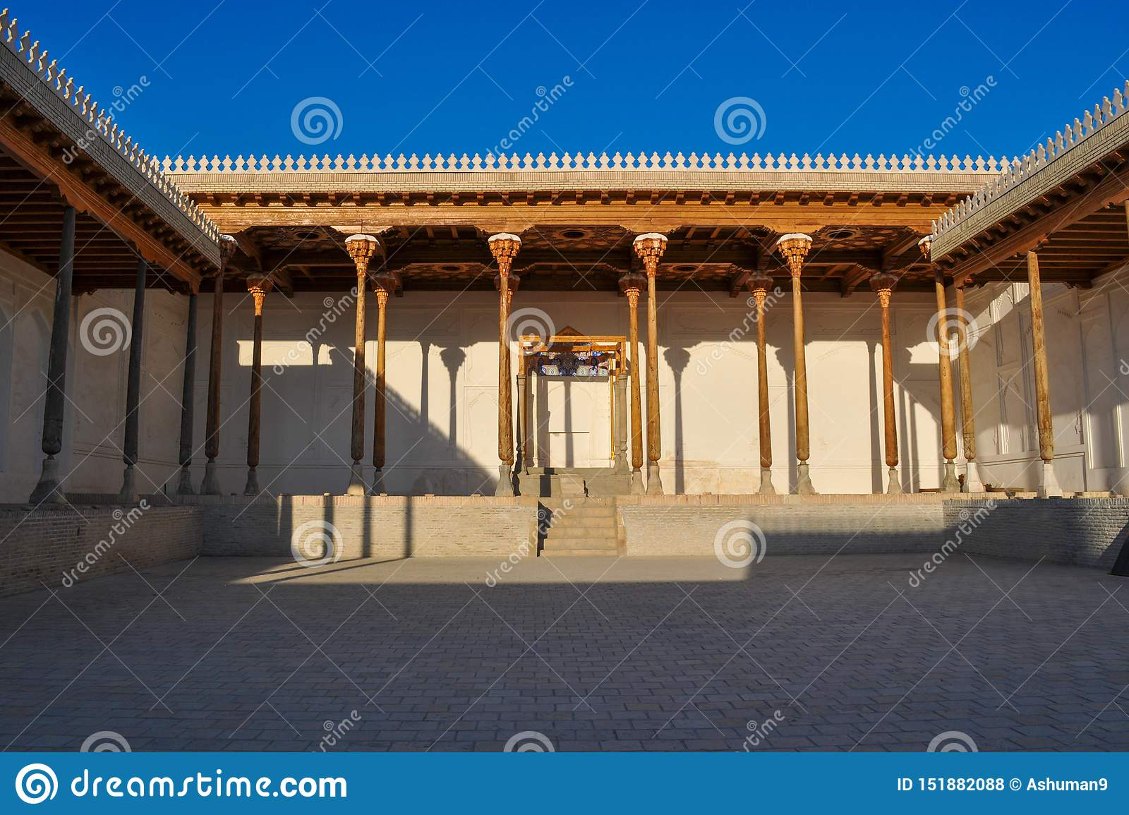 Hall with wooden columns of the ancient citadel in Bukhara `Ark citadel`.