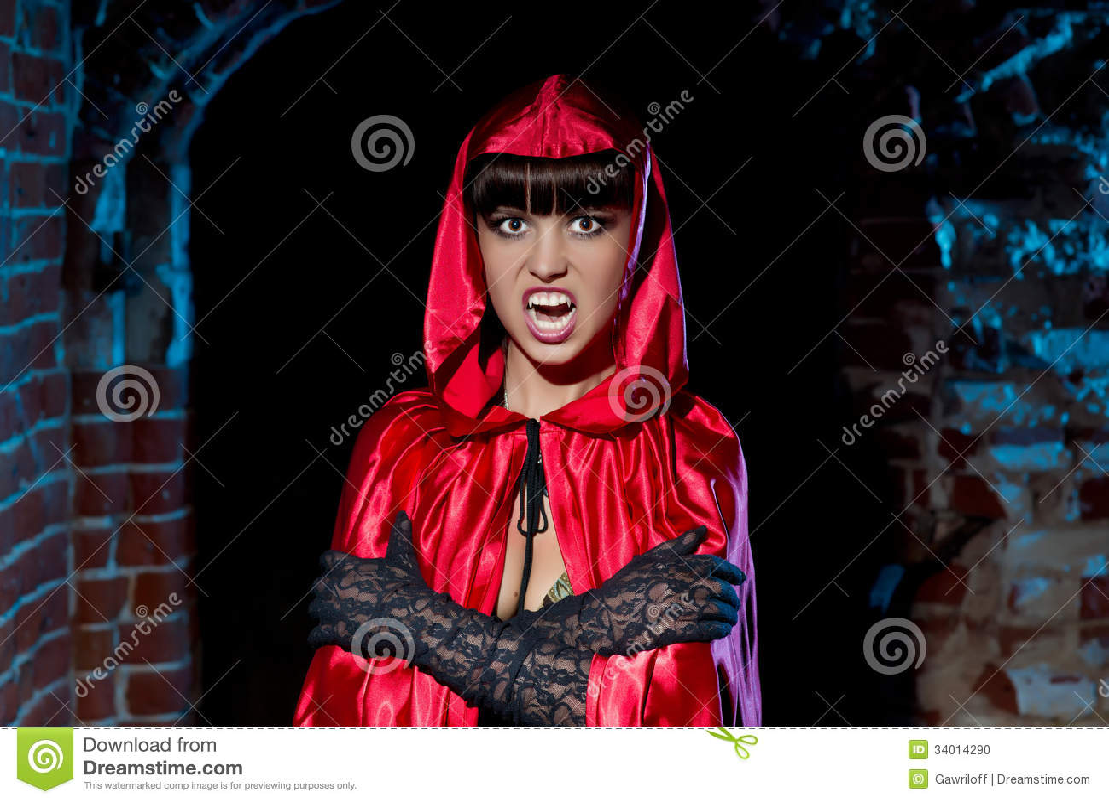 Halloween. Bloodthirsty Vampire Beautiful Woman