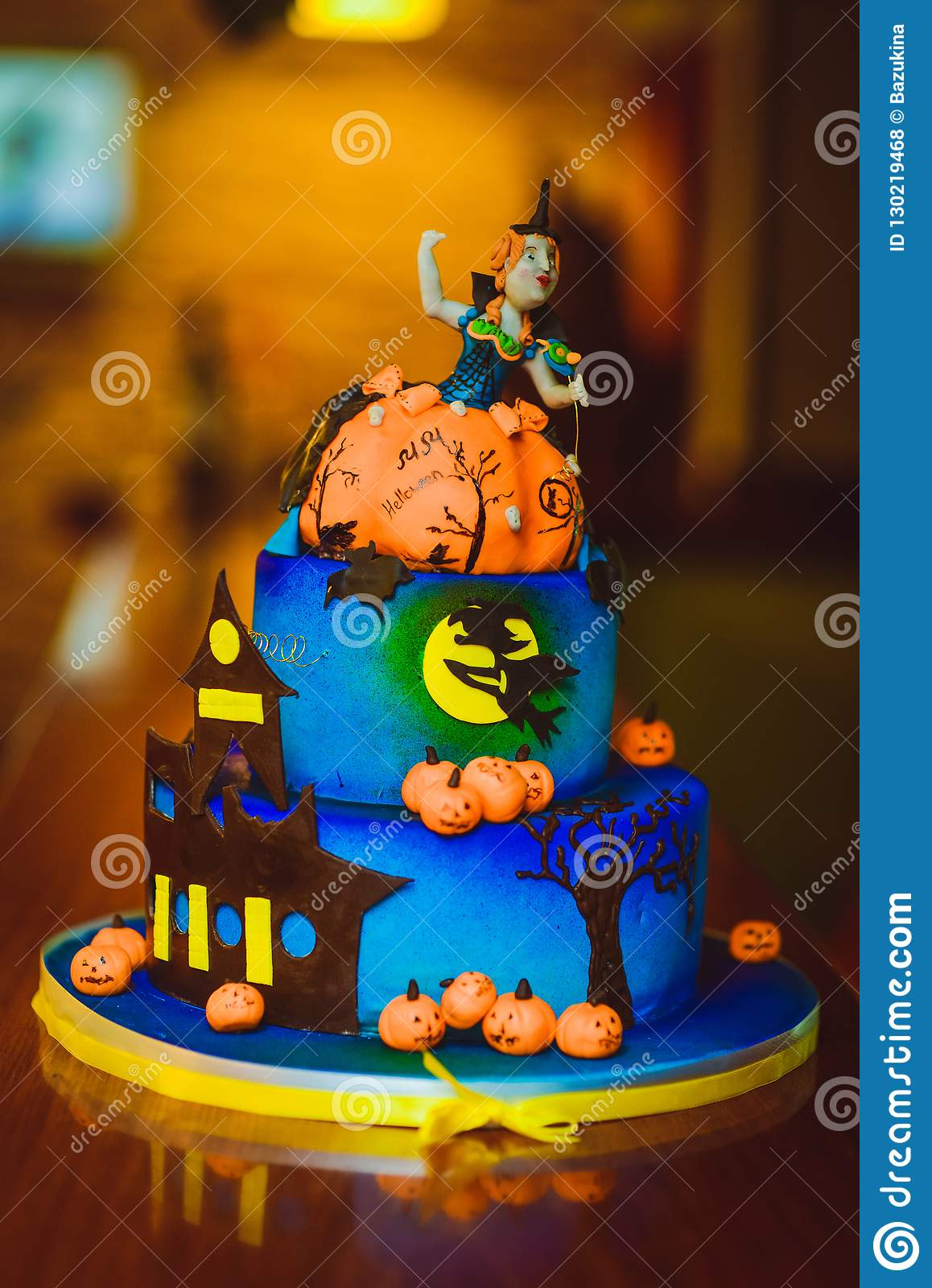 Halloween cake. Festive sweetness. Blue cake with figures of pumpkins and witches
