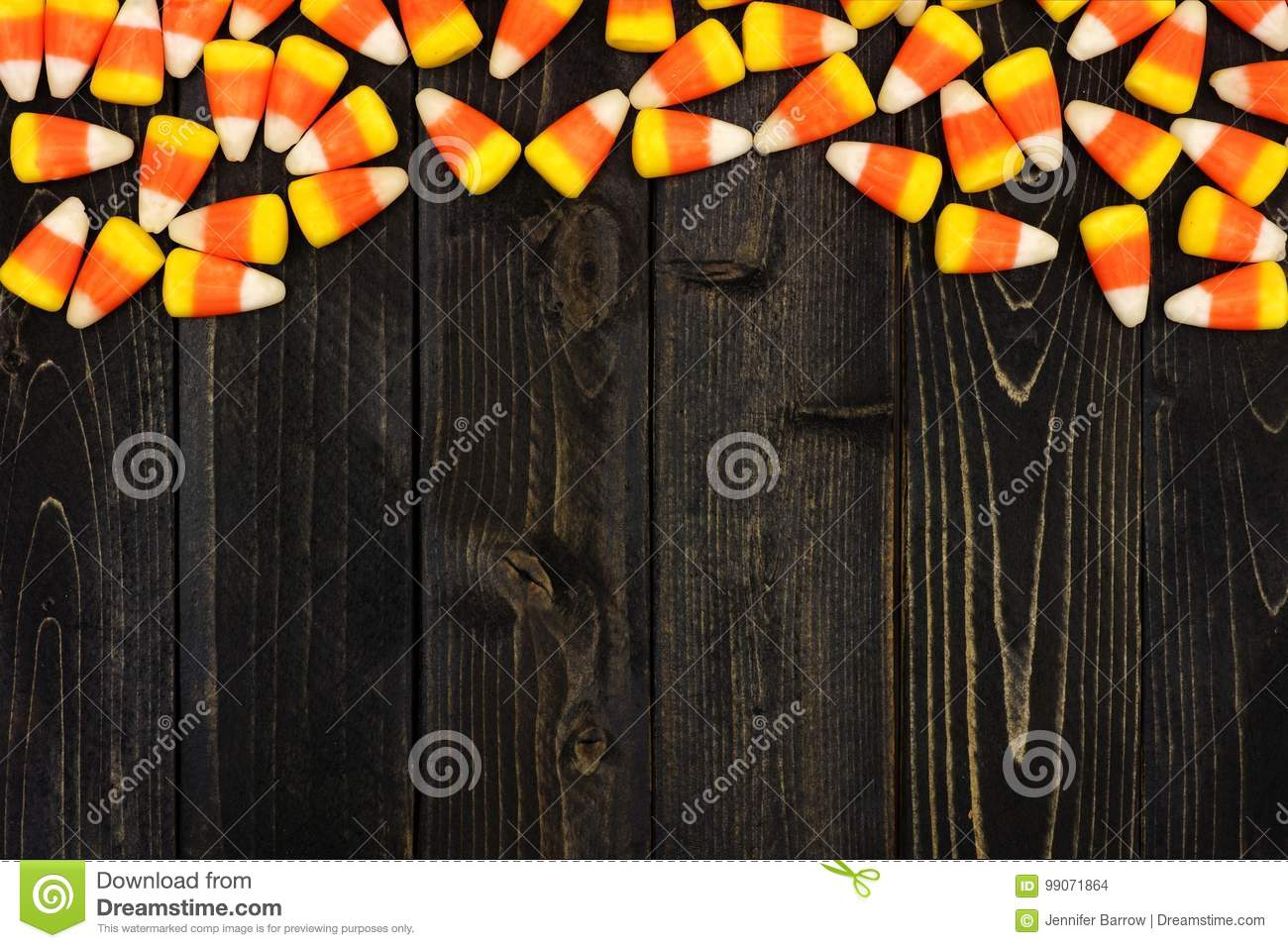 halloween candy corn top border on dark wood stock photo - image of