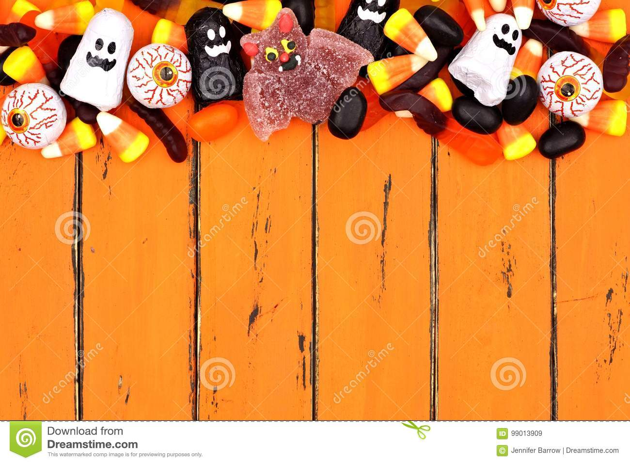 halloween candy top border over old orange wood stock image - image