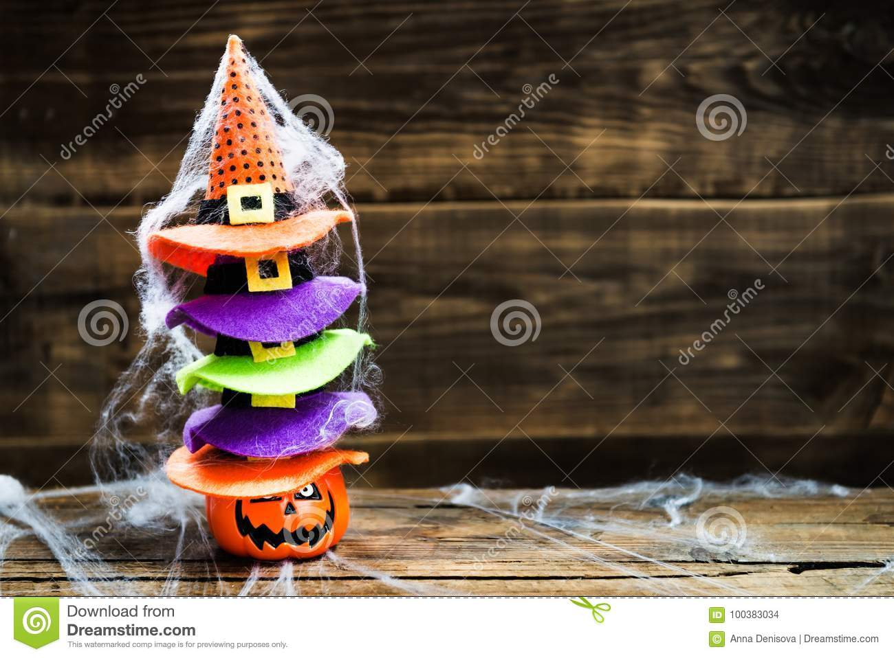 309fed6b71f Halloween card concept with pumpkin head and stack of cute little witch hats  on it