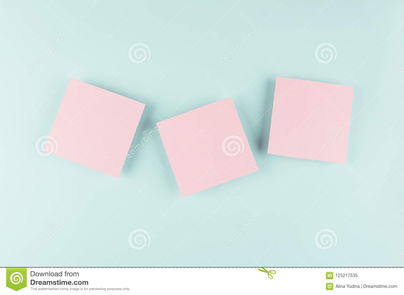 Halloween cartoon mock up for advertising, design, cover - pink paper squares on pastel mint background.
