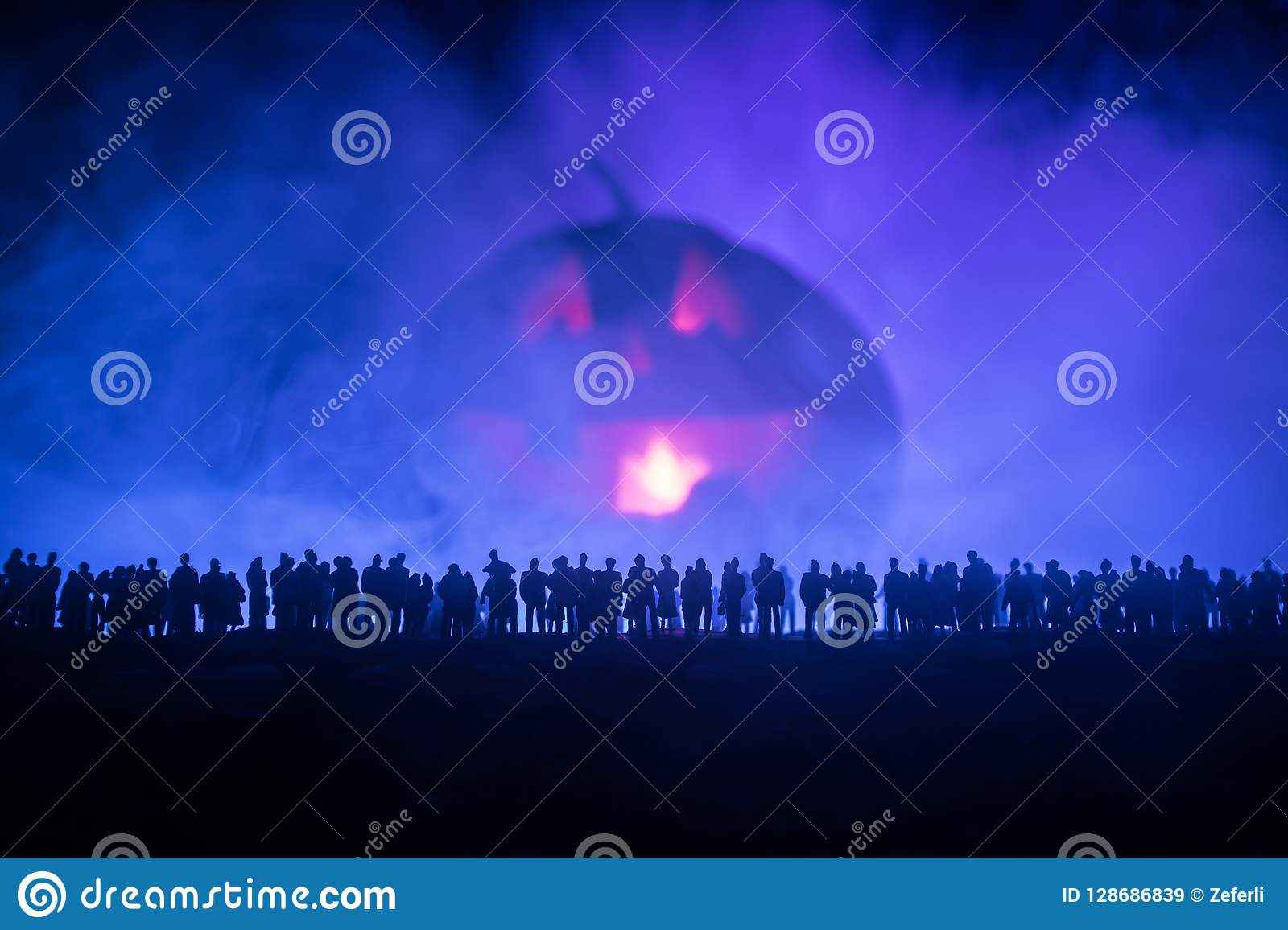 Blurred silhouette of giant monster prepare attack crowd during night. Selective focus.