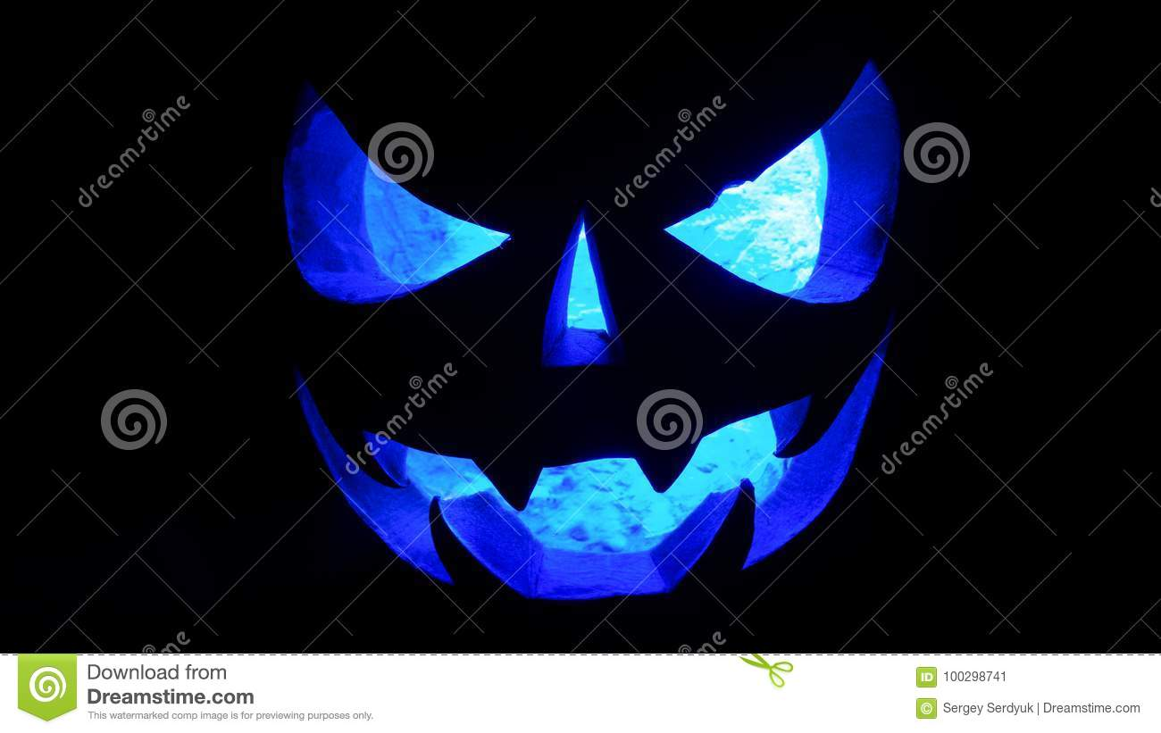 Halloween concept. An ominous pumpkin isolated in the dark, with