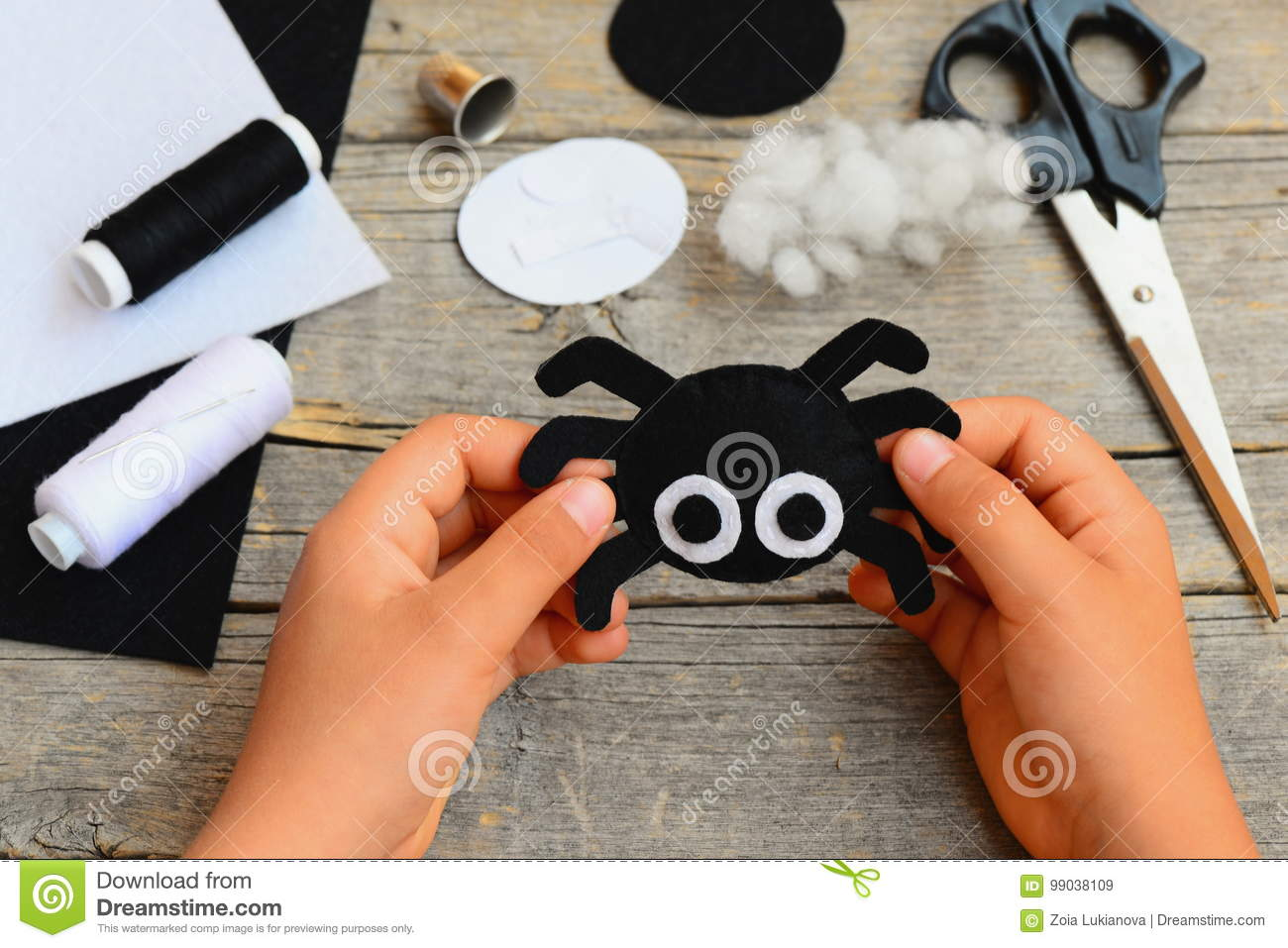 Small Girl Holds A Felt Spider Ornament In His Hand Girl Made A