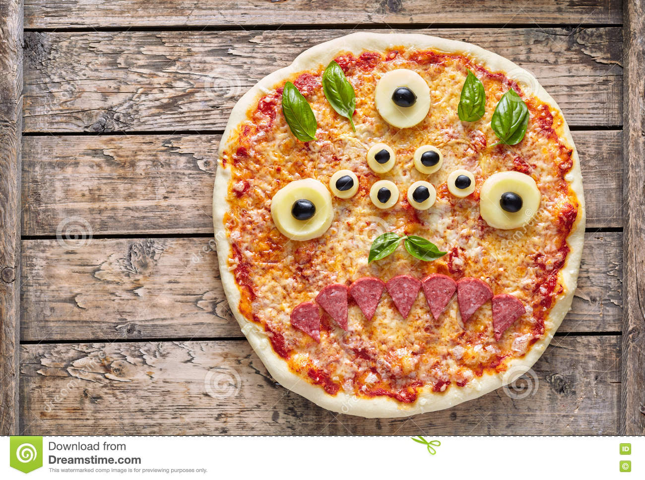Halloween creative scary food eye monster zombie face pizza snack with mozzarella