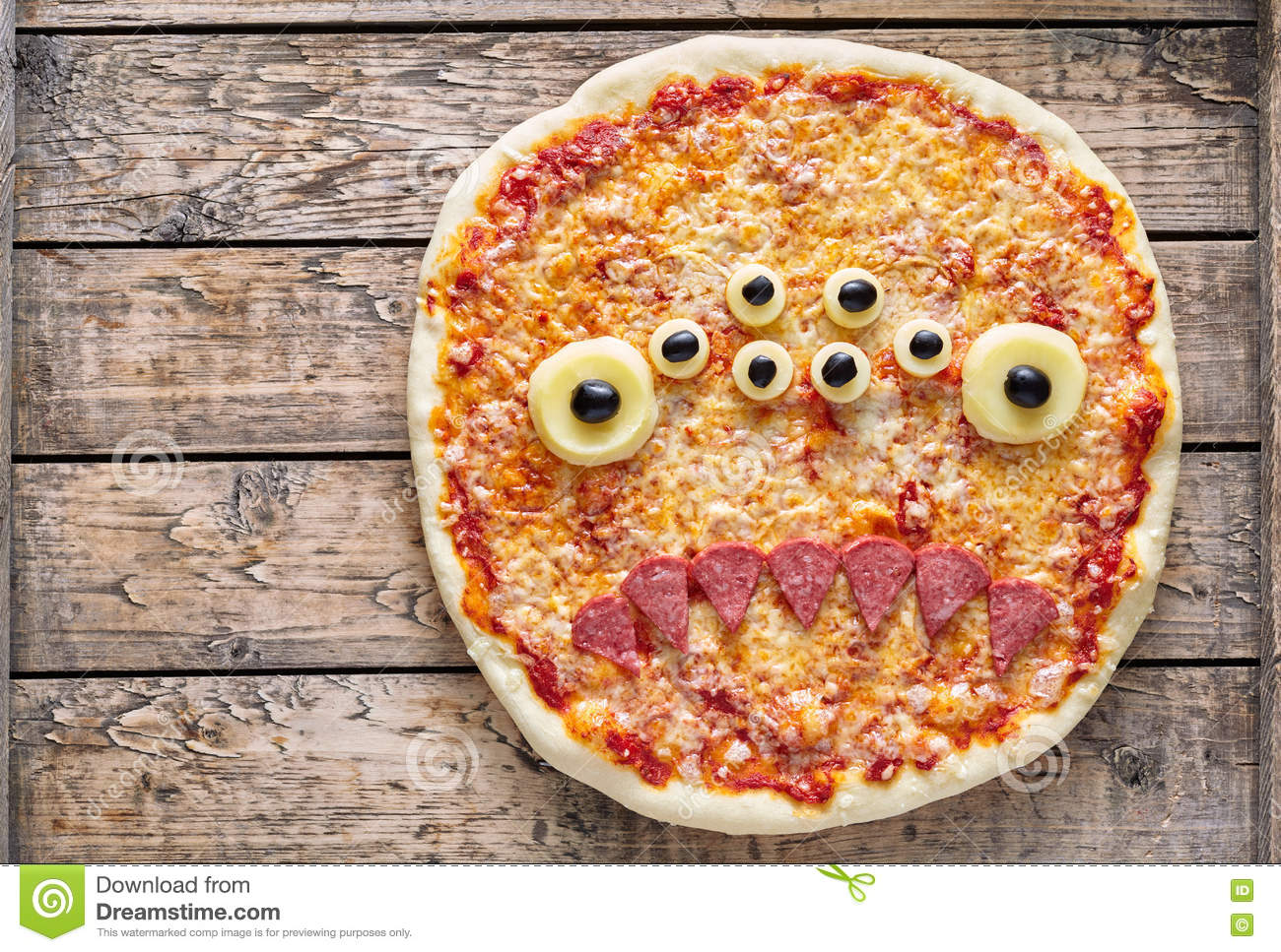 Halloween creative scary food monster zombie face with eyes pizza snack