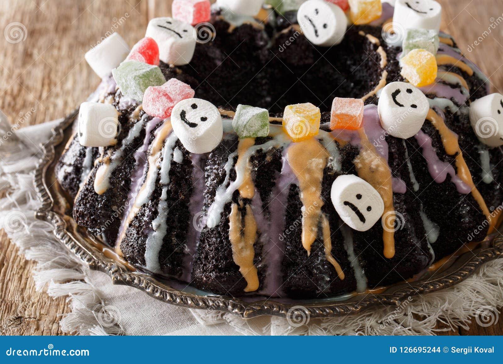 halloween dessert: dark bundt cake with candied fruits, marshmal
