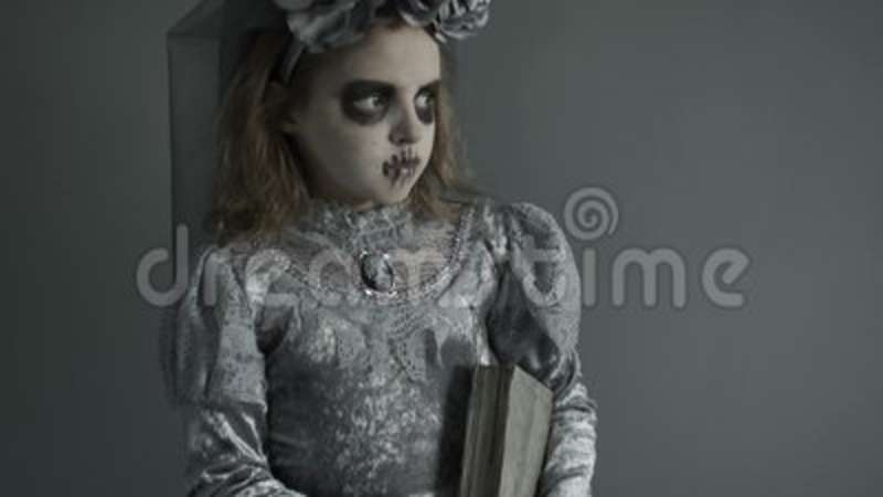 Halloween Face Art. A Portrait Of A Beautiful Zombie Corpse Bride Looked  Scary. Girl In A Witch Costume With A Book Of Stock Footage   Video Of  Costume, ...