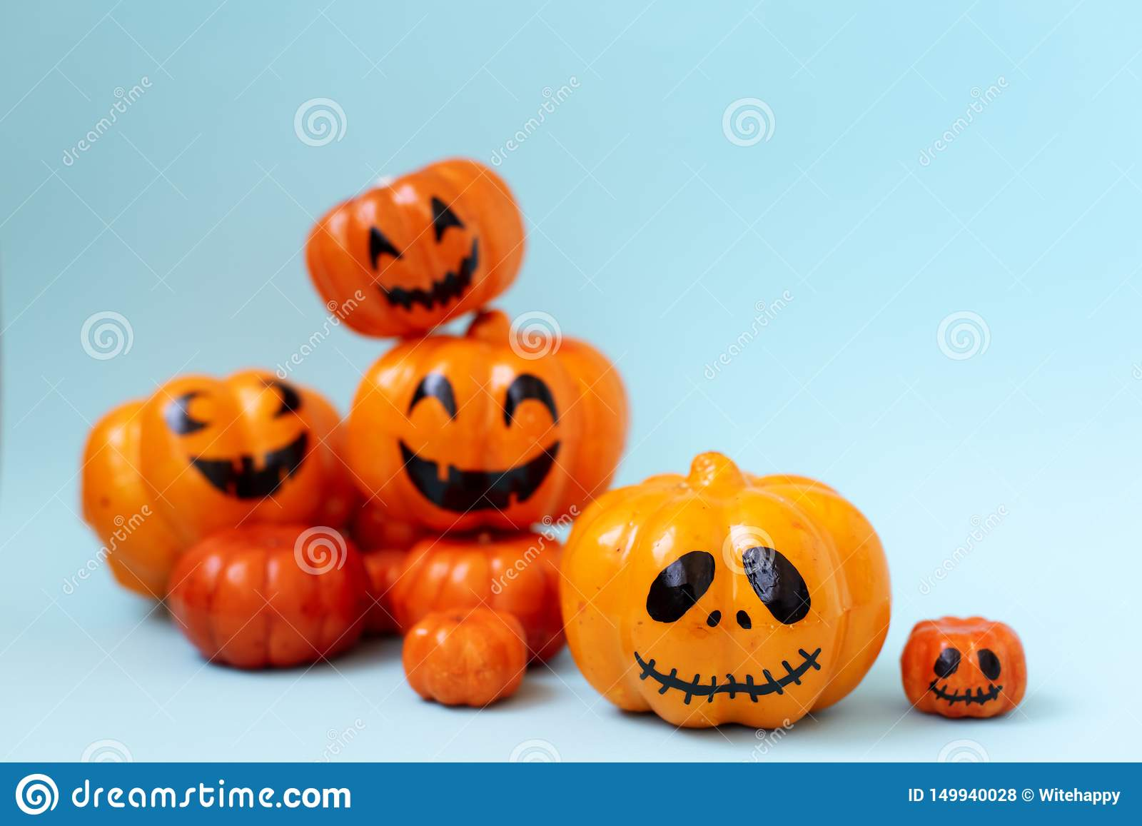 Halloween glitter pumpkin jack o lantern decor with funny faces