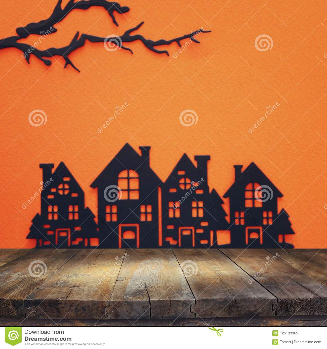 halloween holiday concept. empty rustic table in front of black