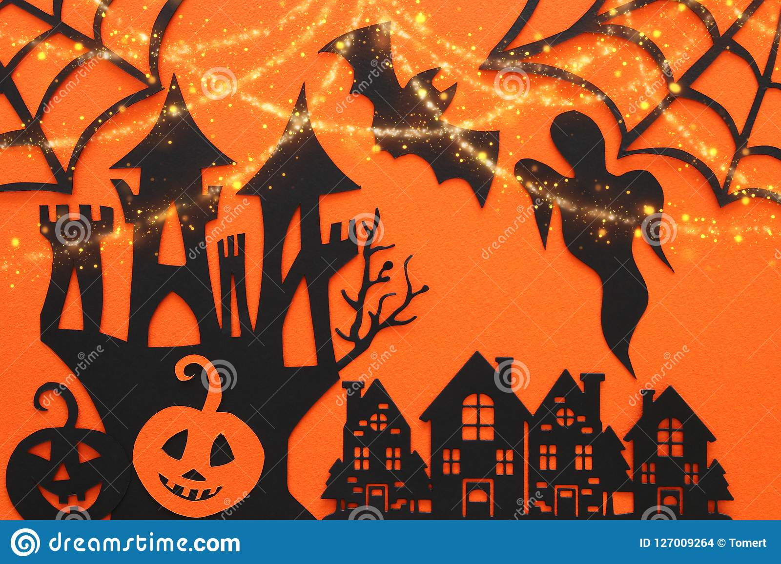 Halloween holiday concept. haunted witch house over orange background. Top view, flat lay.