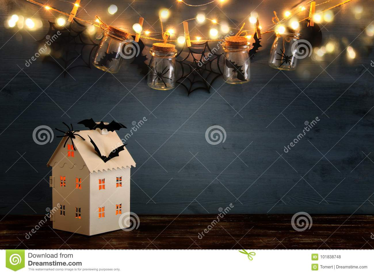 Halloween Holiday Concept. Mysterious House With Lights In Front Of ...