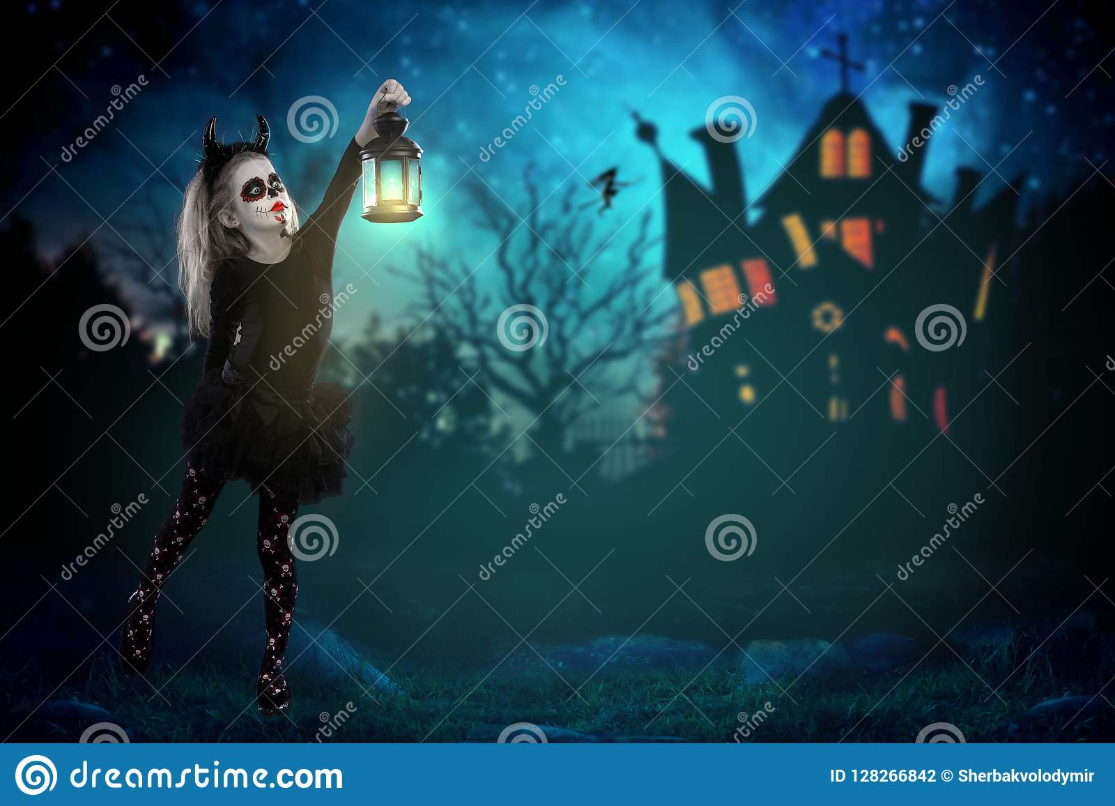 Halloween, holidays, masquerade concept - the portrait of young little beautiful girl with skull makeup holding a lamp. Halloween,