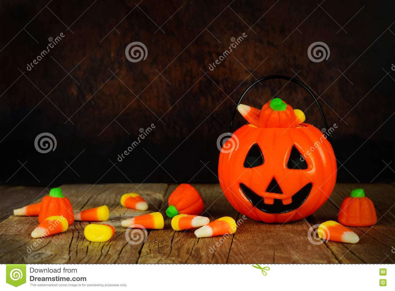 halloween jack-o-lantern candy holder with orange and black