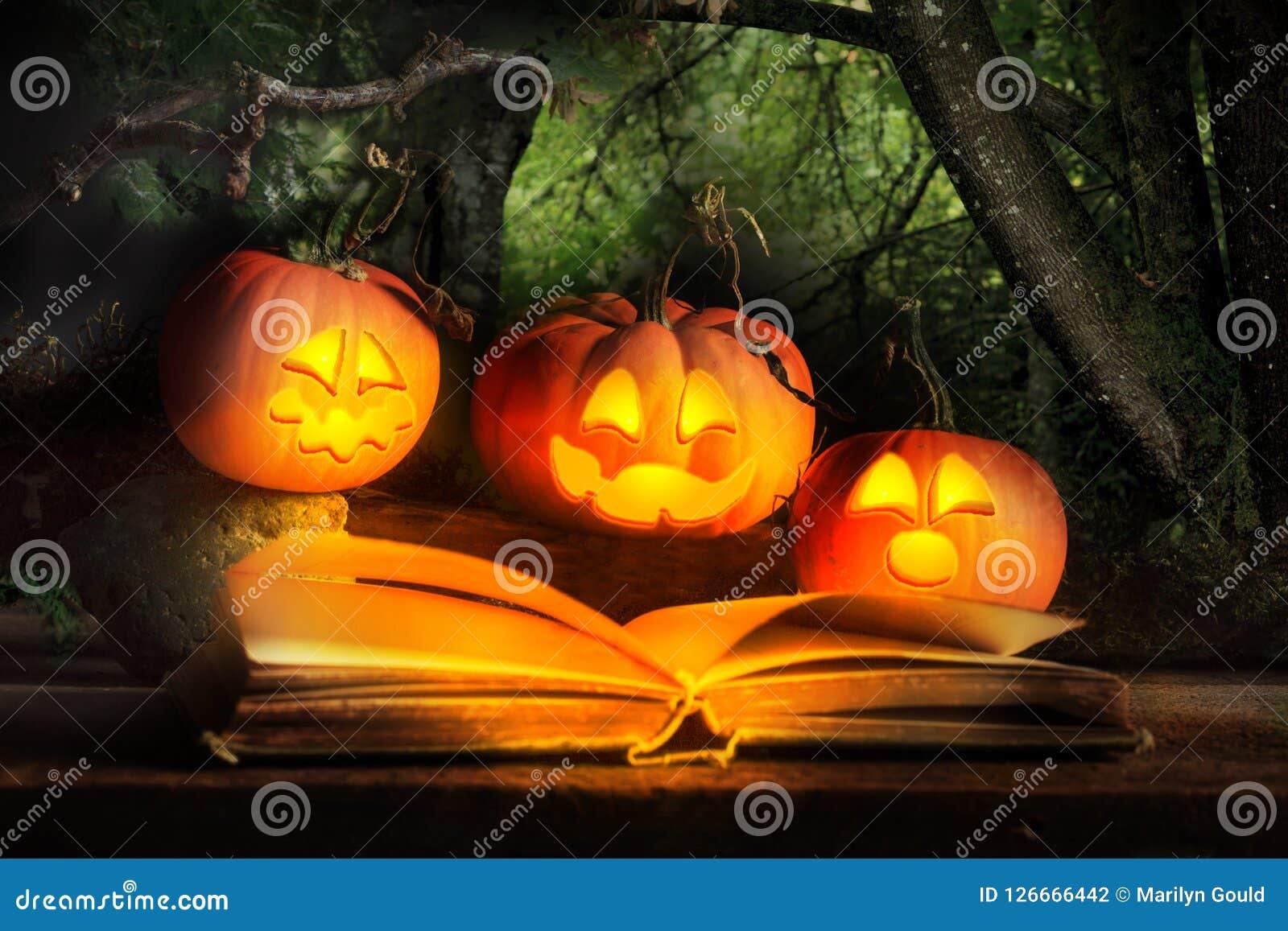 Halloween Jack-O-Lanterns Reading Scary Story Stock Photo