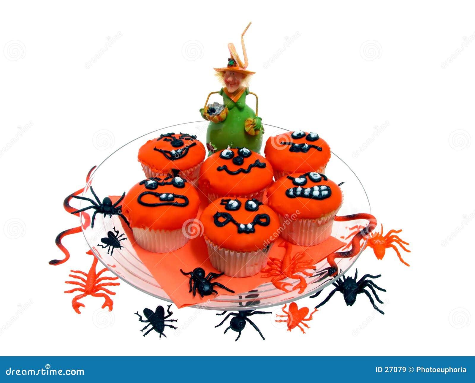 Halloween-kleine Kuchen mit Gummiprogrammfehlern u. Spinnen