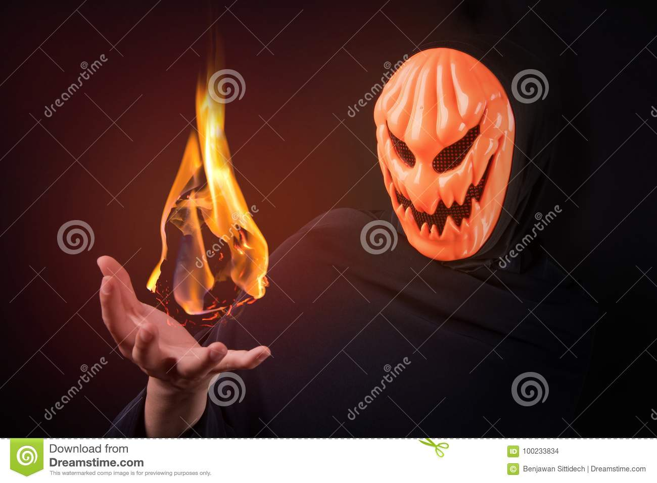 Halloween Maan.Halloween Man With Pumpkin Mask Control Fireball Stock Photo