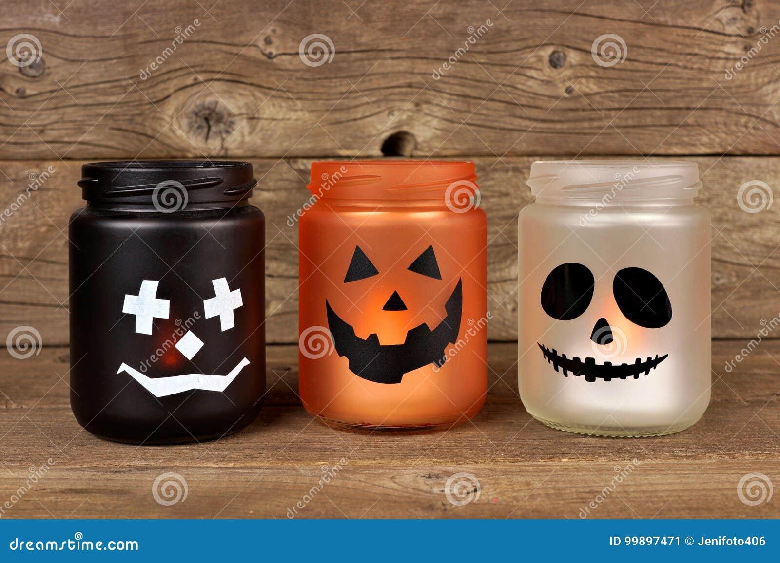 halloween mason jar candle holders stock image - image of lantern