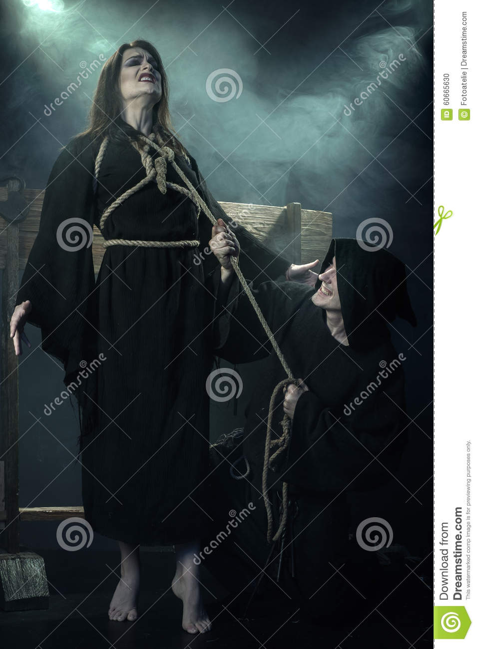 Halloween. Monk executed witch. The Middle Ages