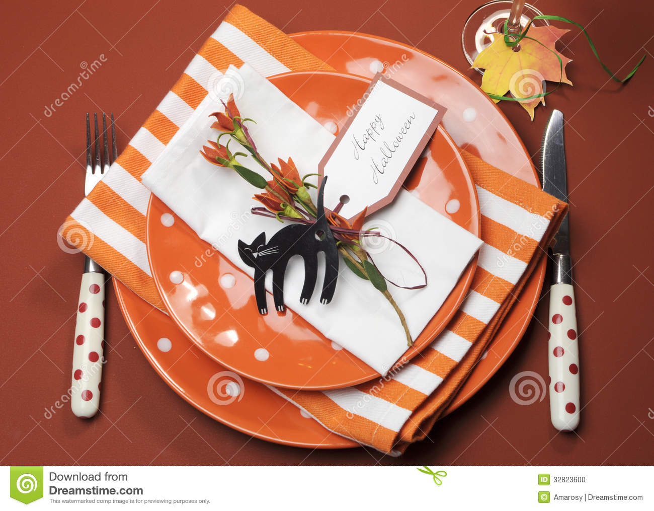 Halloween orange polka dot and stripes dinner table setting aerial