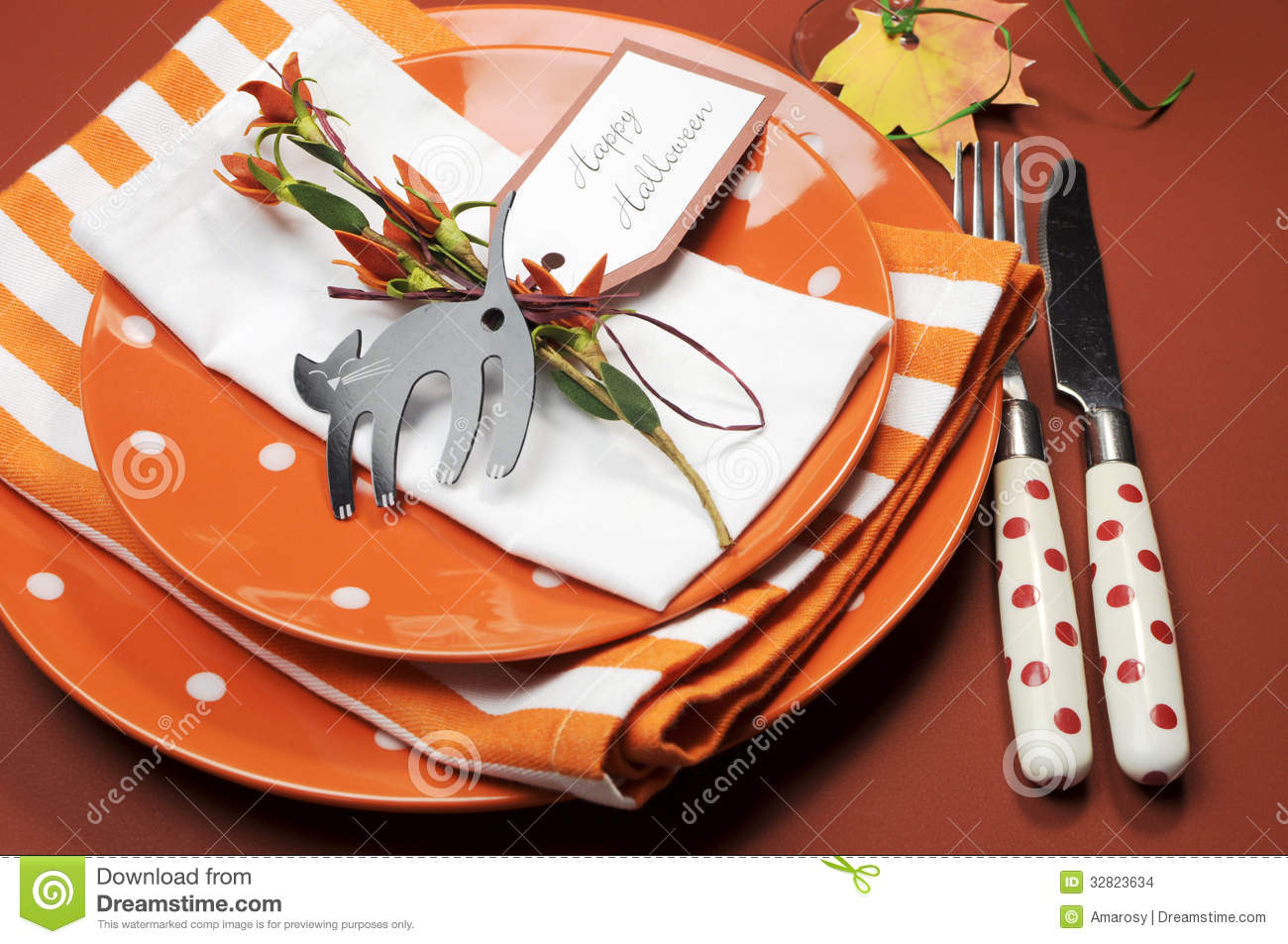 halloween orange polka dot and stripes dinner table setting close up stock images - Halloween Place Settings