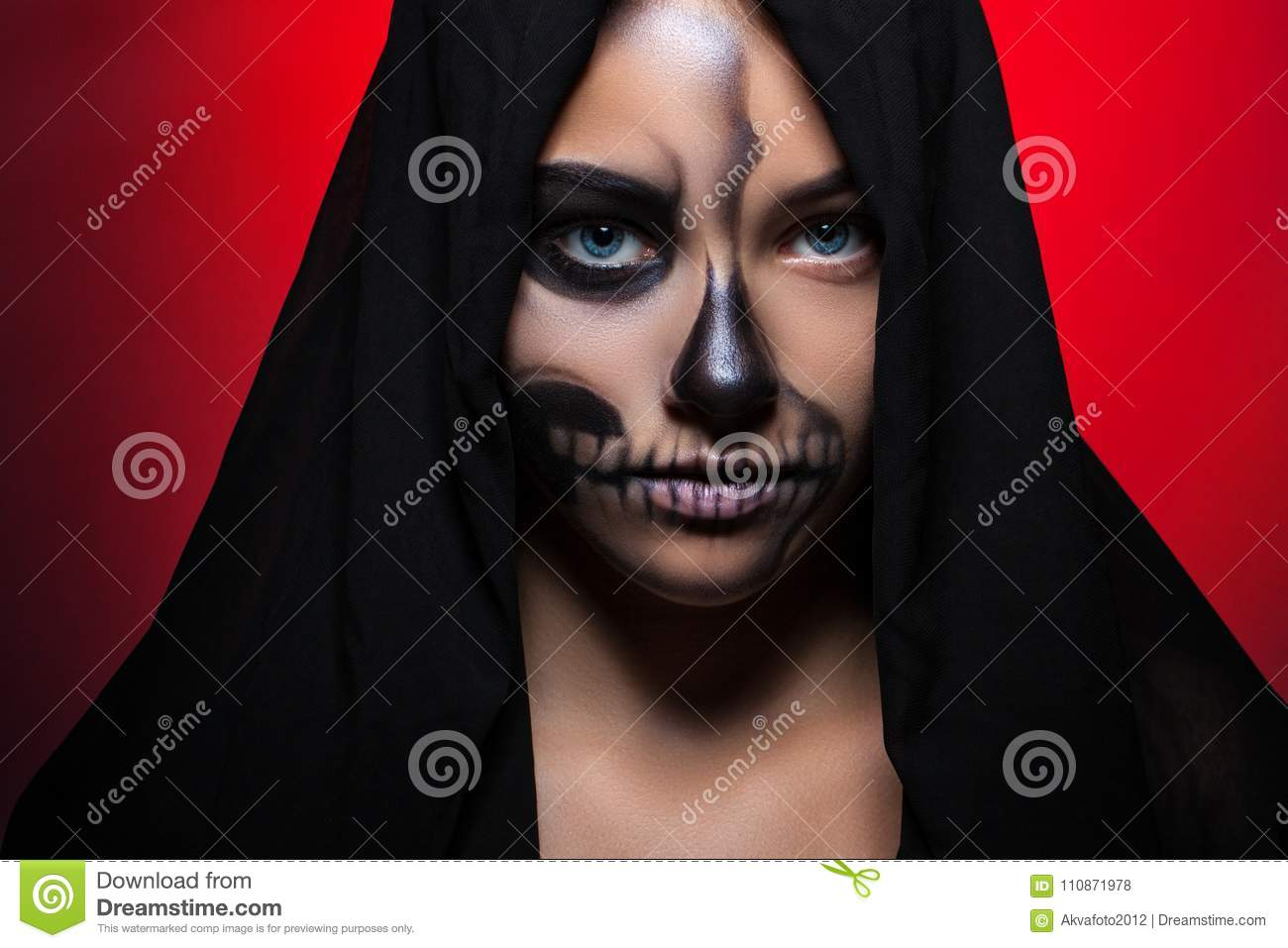 Halloween. Portrait of a young beautiful girl with skeleton makeup on her face.