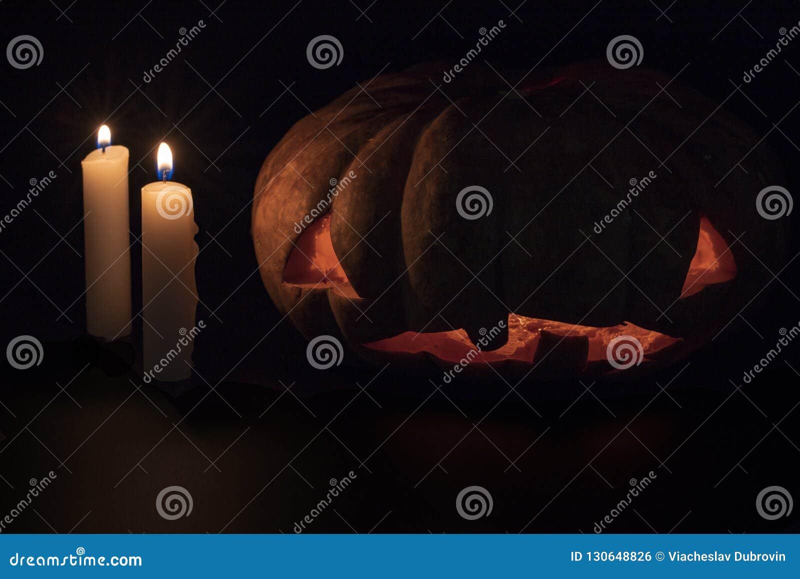 Halloween Pumpkin And Candle On Dark Background Halloween Eve