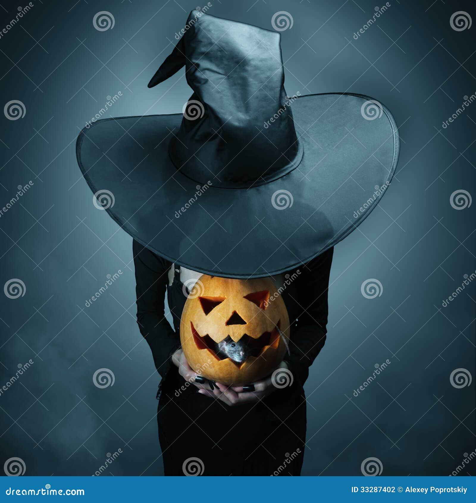 Halloween pumpkin and gray rat