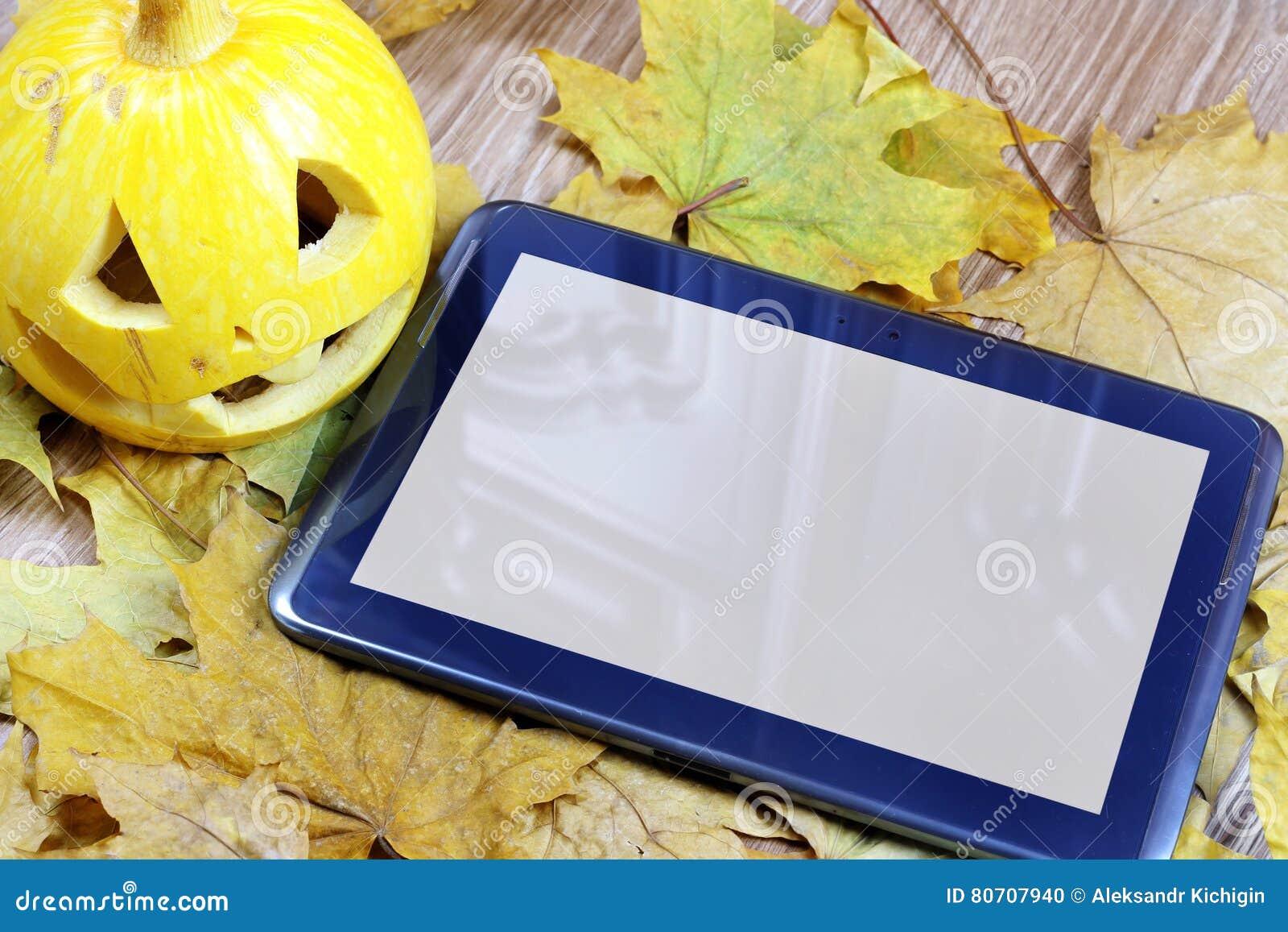 halloween pumpkin and tablet stock photo - image of halloween