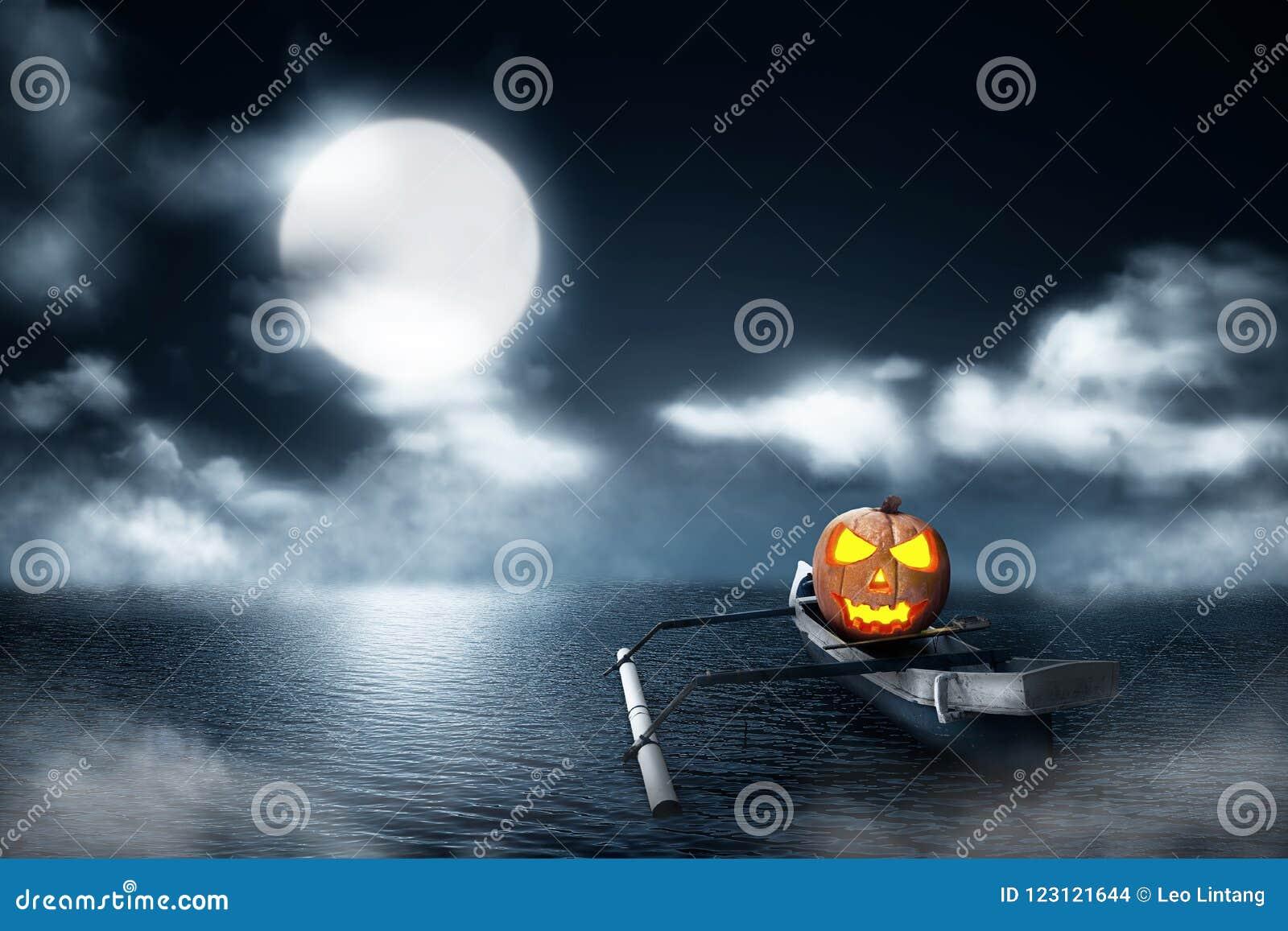 Halloween pumpkin in wooden boat on foggy lake