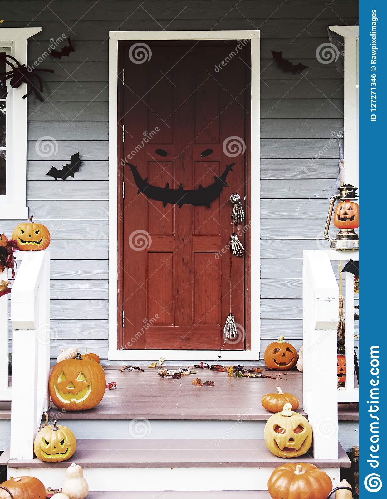 Halloween Pumpkins And Decorations Outside A House Stock Photo - Use-pumpkins-to-decorate-your-house-for-halloween