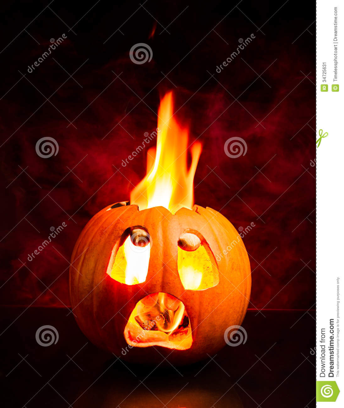 halloween scared pumpkin with flames and red smoke. stock image