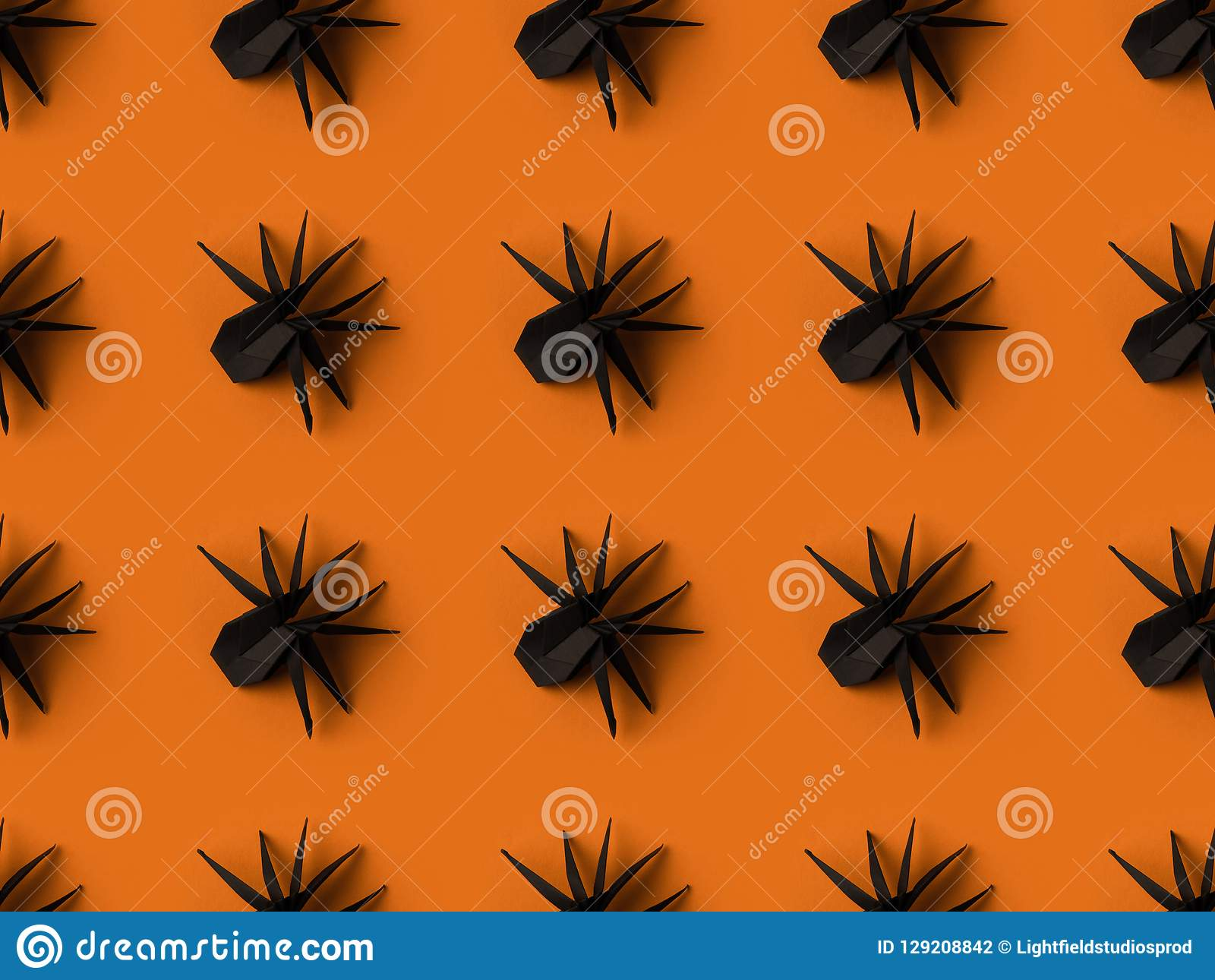 halloween texture with black origami spiders