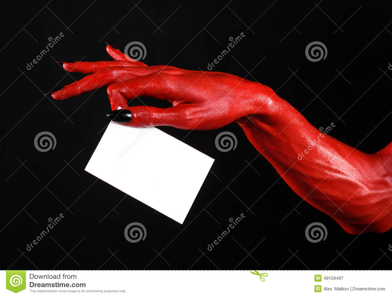 halloween theme red devil hand with black nails holding a blank