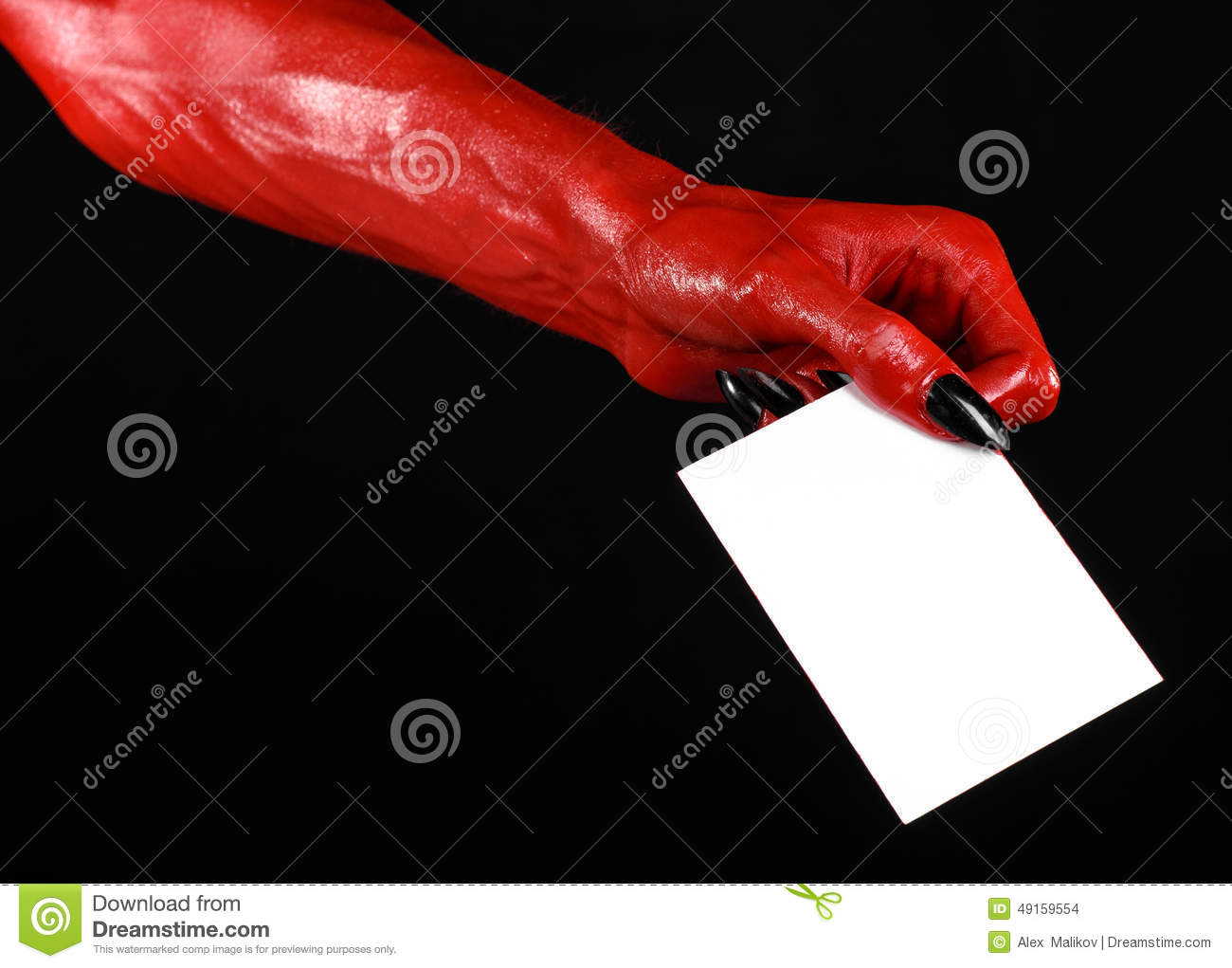 Halloween Theme: Red Devil Hand With Black Nails Holding A ...