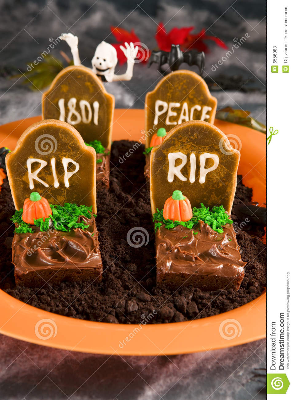 Halloween tombstone made of brownies and sugar cookies on a bed of ...
