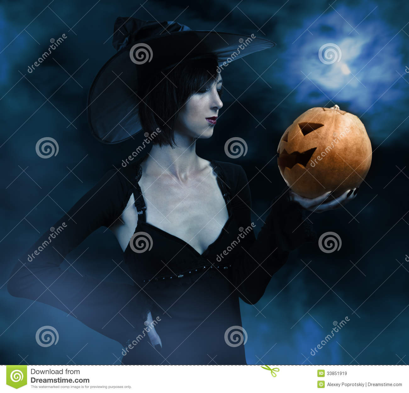 Halloween witch with a pumpkin
