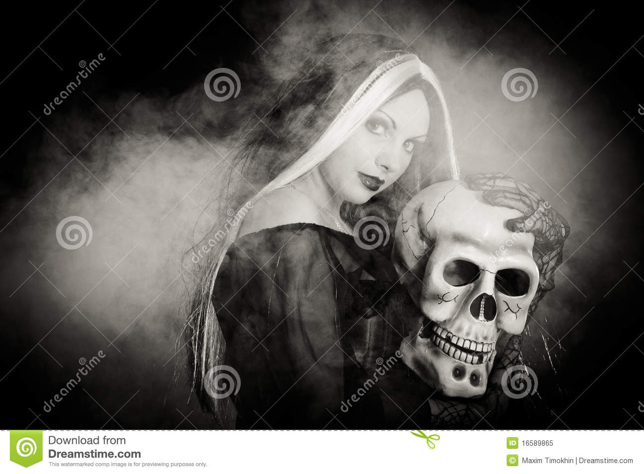 Halloween witch with a skull