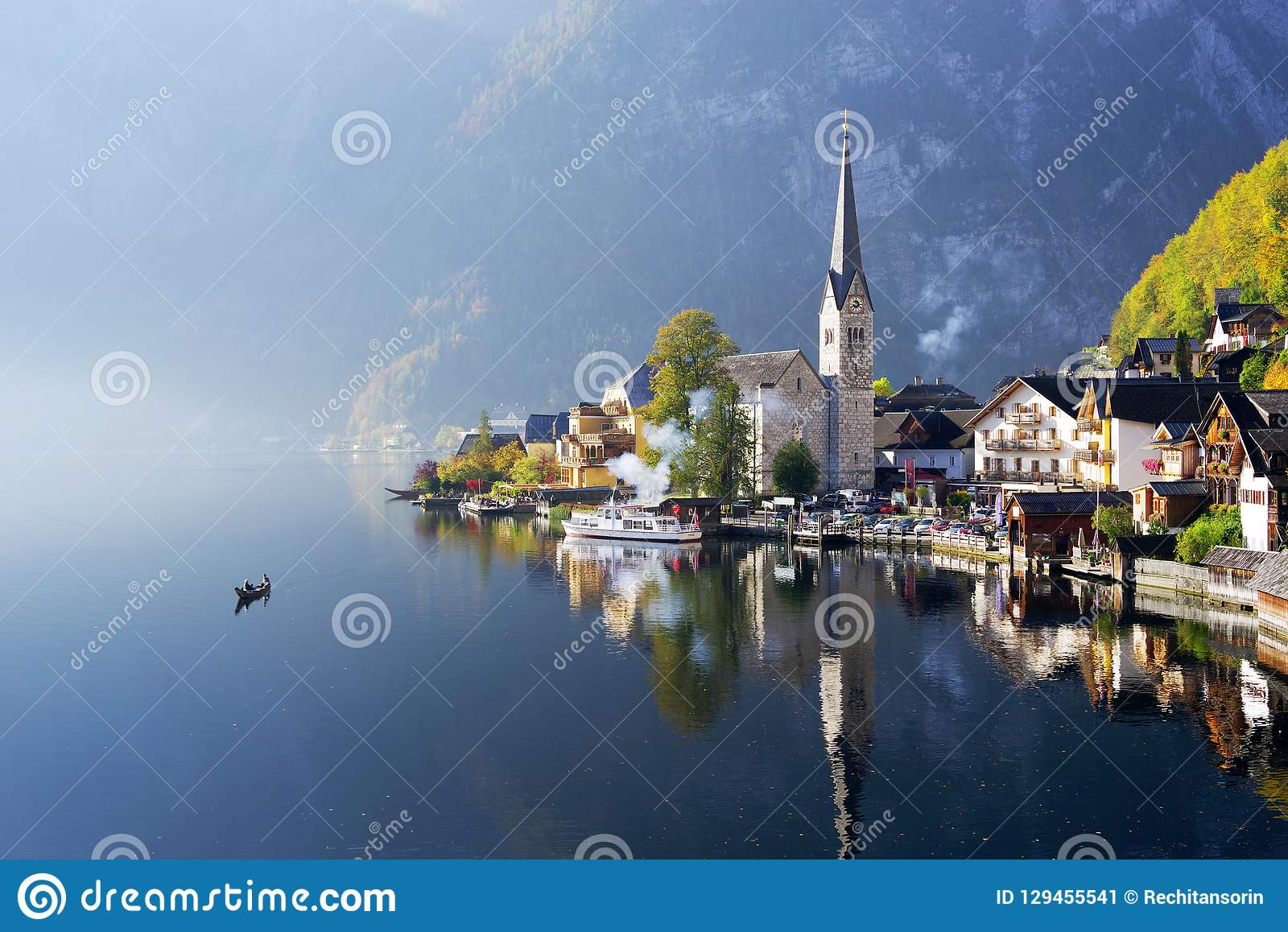 The famous Hallstatt lake in a autumn foggy morning