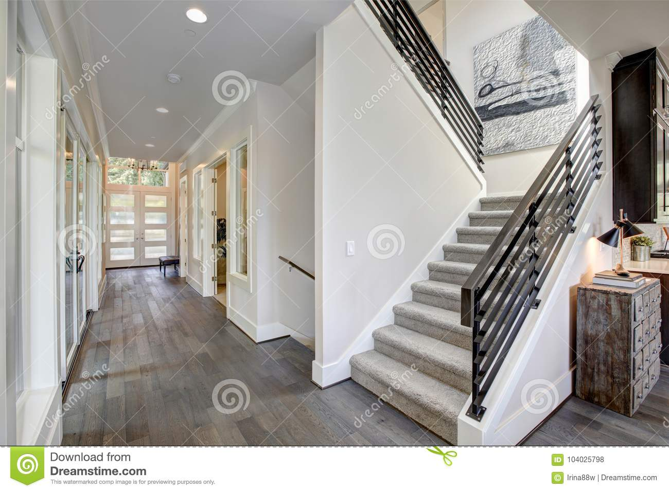Hallway Features A Staircase With Gray Carpet Runner Stock
