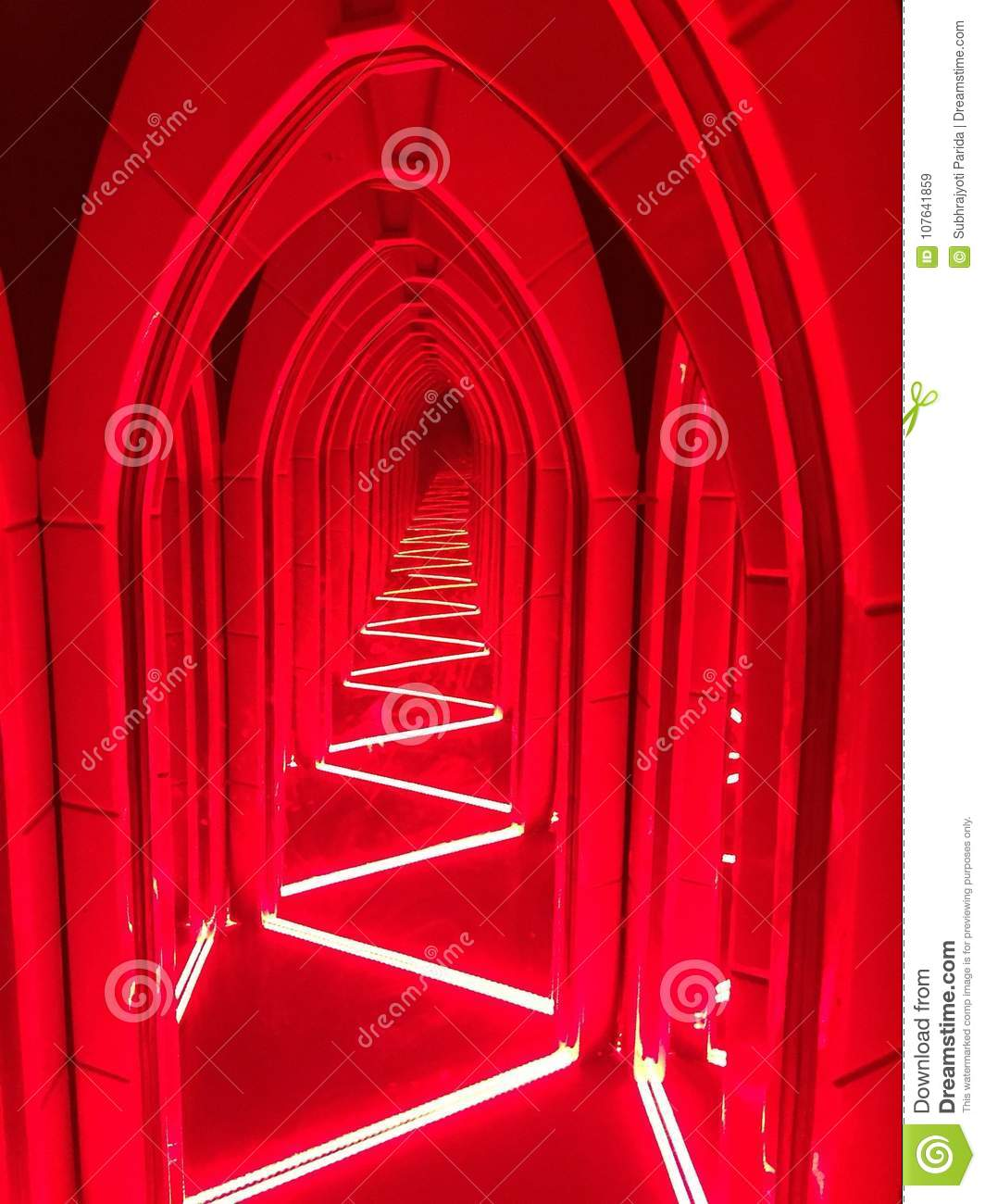 A hallway lit with bright red light