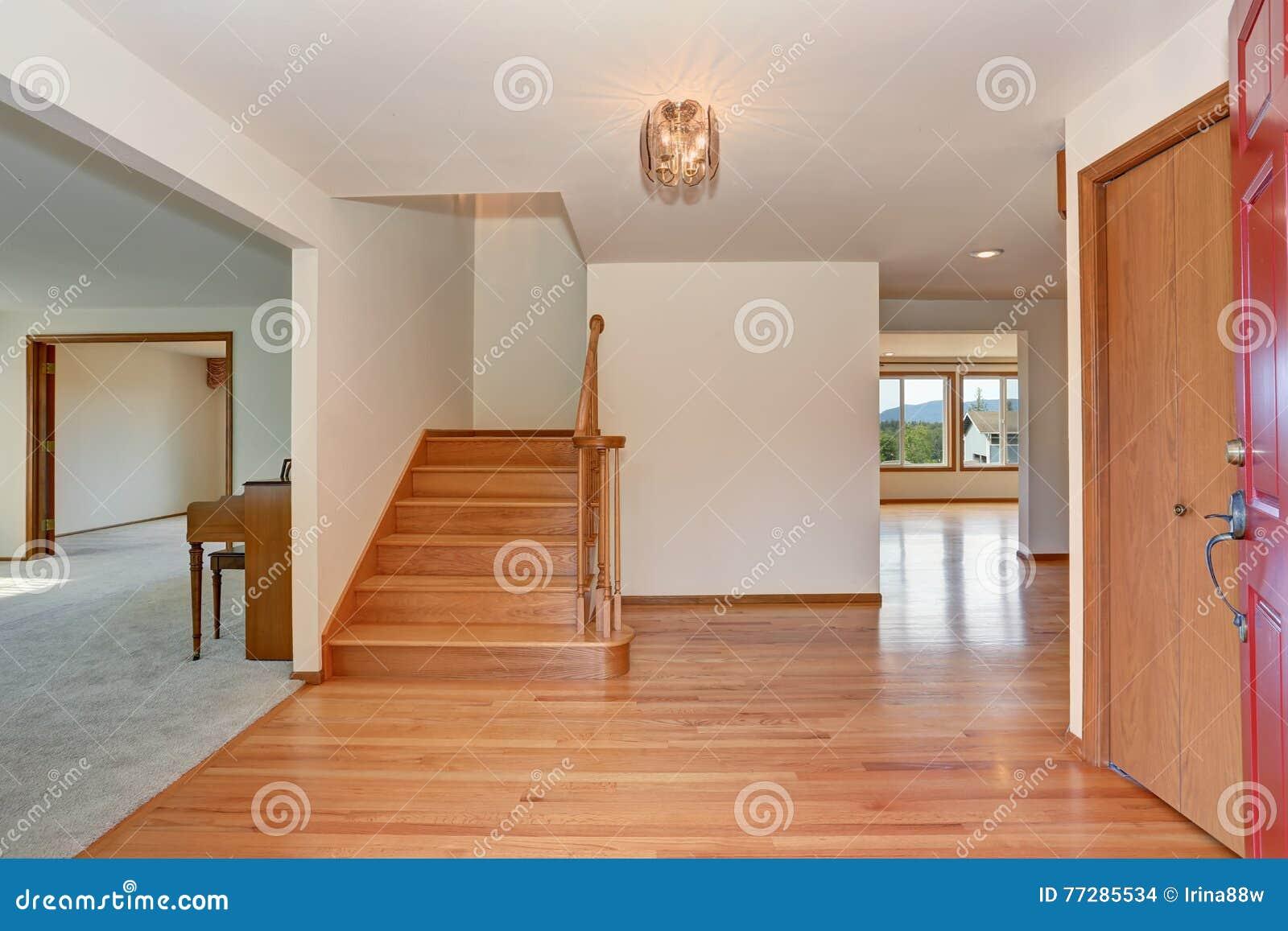 hallway interior with hardwood floor view from opened front door