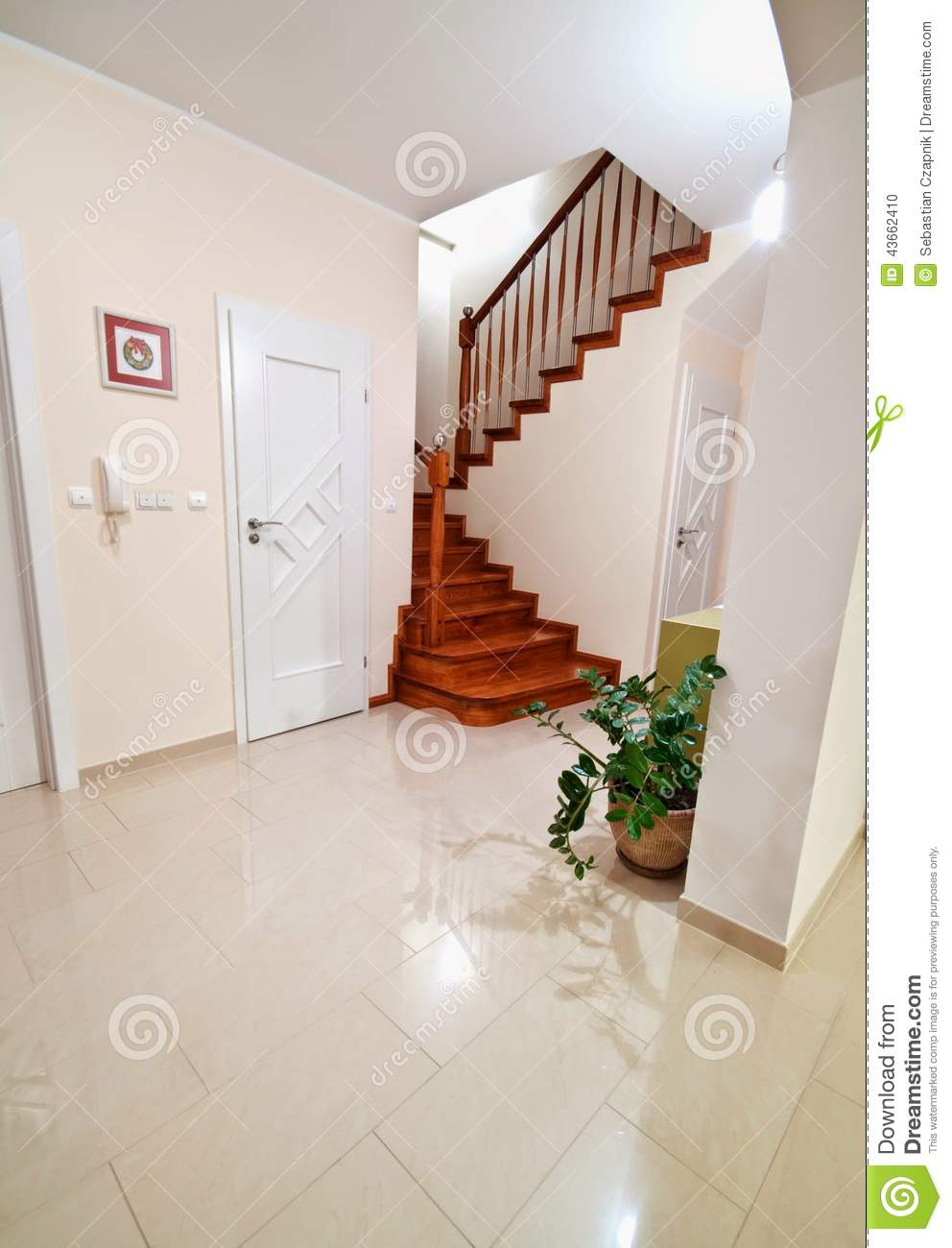 Hallway with wooden stairs to upper floors stock photo for Hallway photos