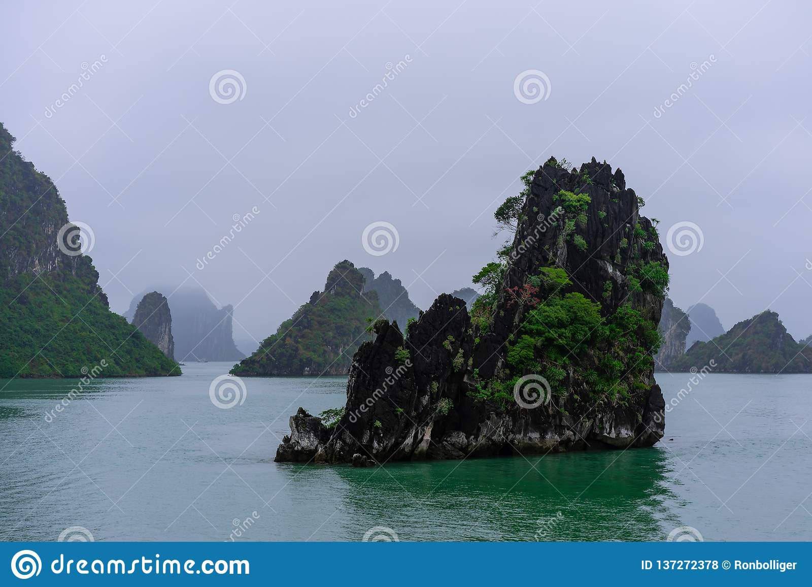Halong Bay in mystical clouds.