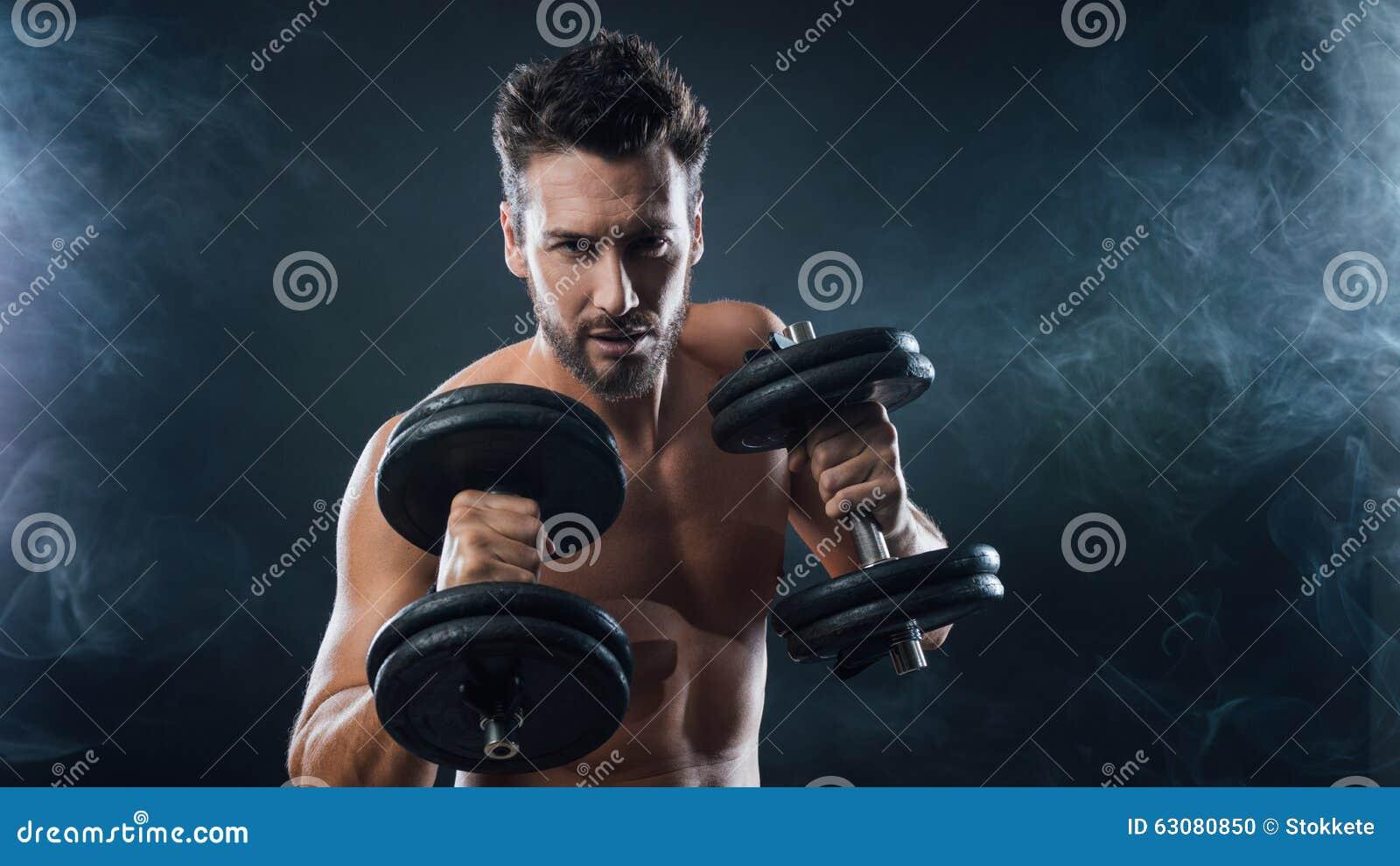 Download Haltérophilie Attrayante D'homme Photo stock - Image du shirtless, club: 63080850