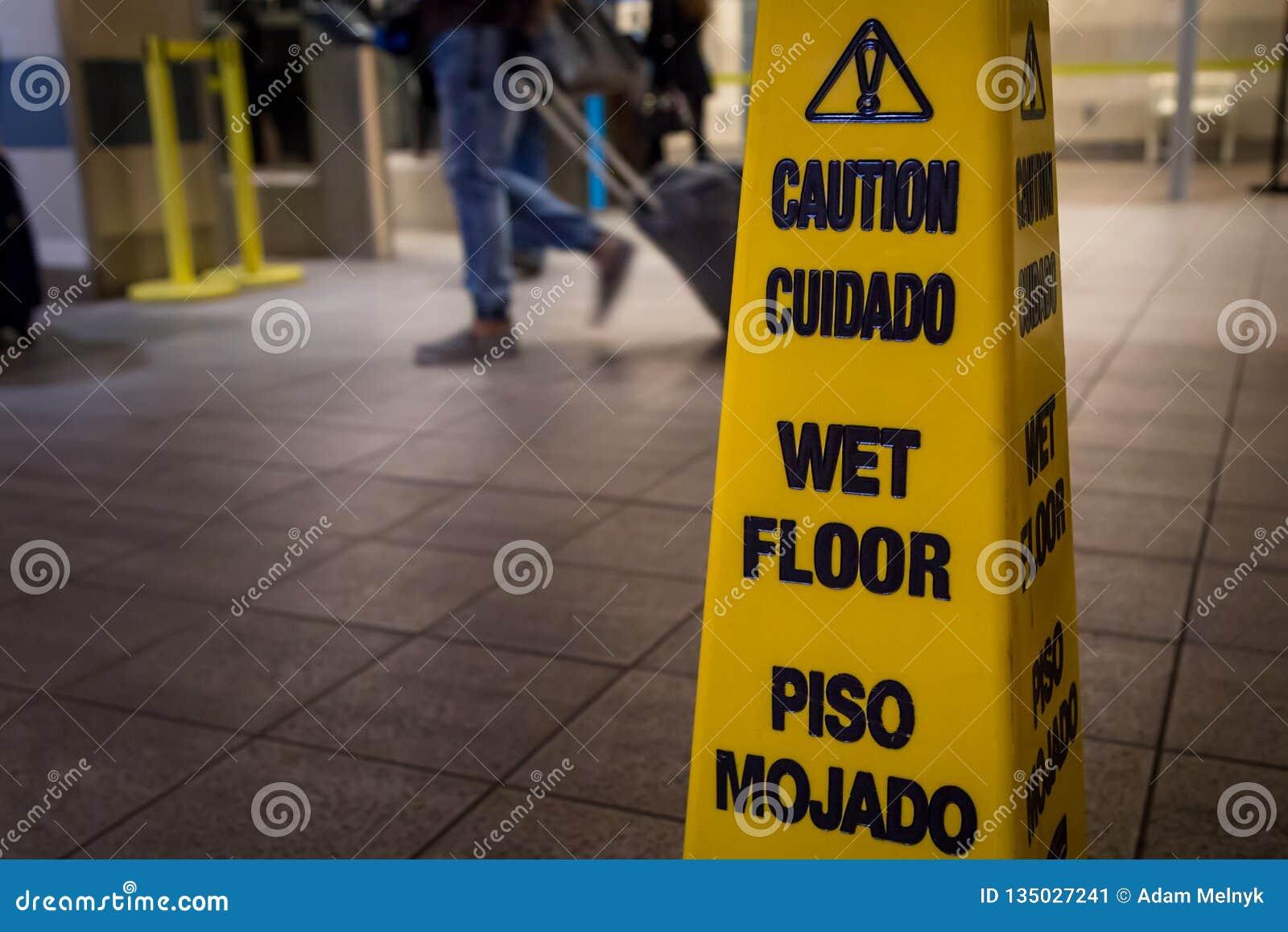 Halt vått golvtecken för gul varning