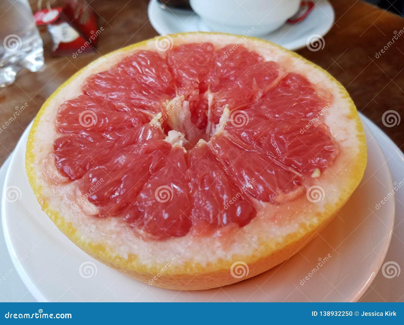 Halved red grapefruit